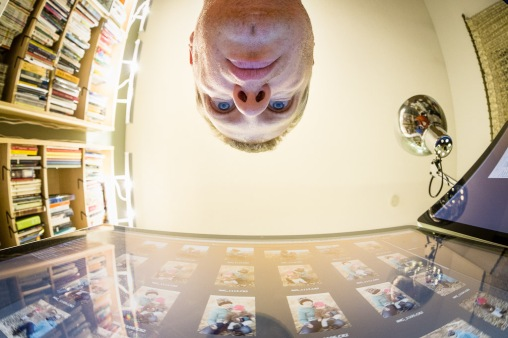 Fisheye Selfie While Editing Photographs