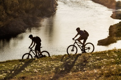Mountain Bikers By The Bow River